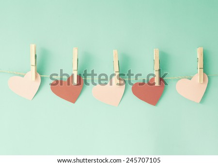 Hearts and clothe pins  - stock photo