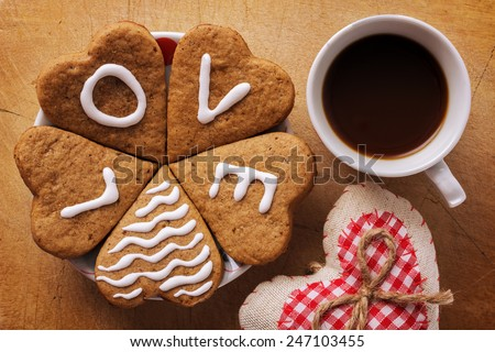 Hearts and coffee on a wooden background - stock photo