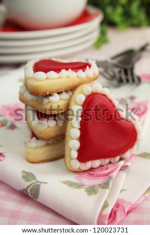 Hearts cookies with plate and fork in background - stock photo