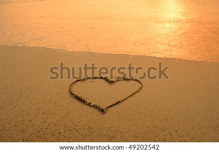hearts drawn in beach