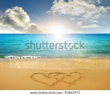 hearts drawn in beach - stock photo