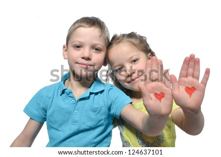 hearts drawn on the hands of children - stock photo