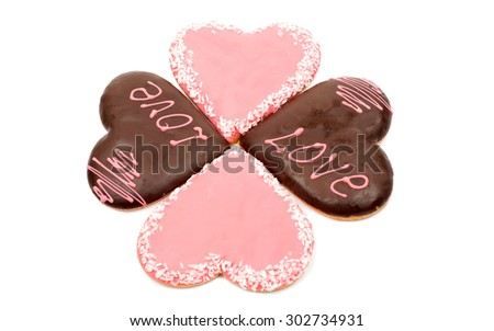 Hearts frosting cookies in a white background - stock photo