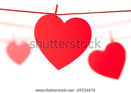 Hearts hanging on rope. Isolated on white.