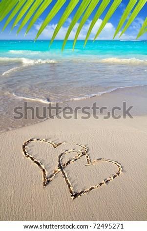 hearts in love written in Caribbean beach sand tropical aqua sea [Photo Illustration] - stock photo