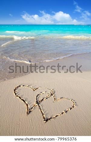 hearts in love written in Caribbean tropical beach sand [Photo Illustration] - stock photo