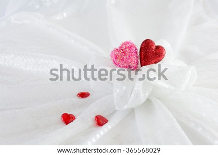 Hearts - Love. Two different colors of the hearts represent female and male out of fabric shaped like a bouquet.