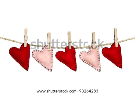 Hearts on a clothes line isolated on white