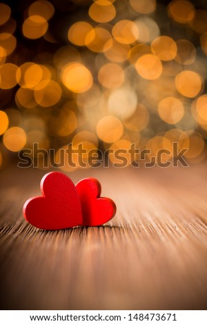 Hearts on a wooden table and background is a bokeh. - stock photo