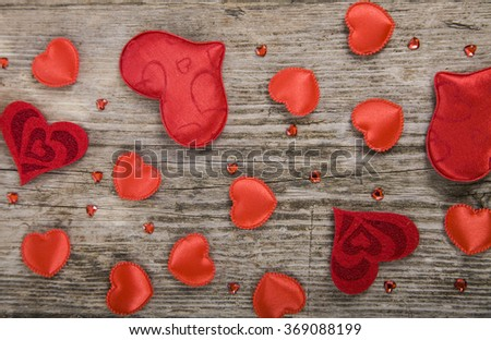 Hearts on an old wooden background. Valentine's Day card.