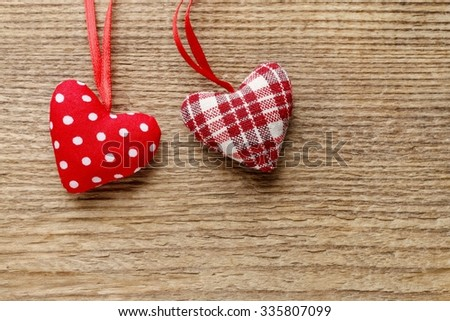 Hearts on brown wooden background, copy space - stock photo