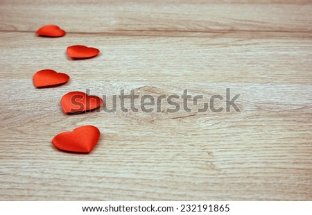Hearts on the wooden background