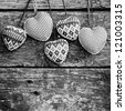 Hearts on wooden background. Valentine`s day concept. Black and white - stock photo