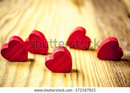 hearts on wooden background with lights