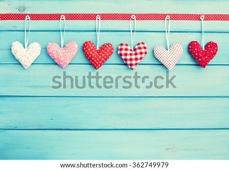Hearts over blue wood  - stock photo