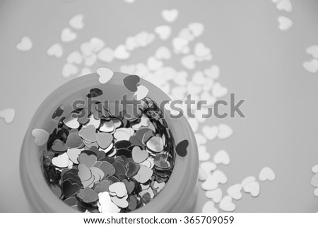 Hearts sparkles in the jar. Valentines day surprise present. Black and white photo. Grey photo can be used for web design, wallpapers, printed products and other.