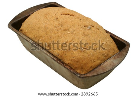 Hearty Bread Rising. Multi grain unbaked homemade bread. 100% organic ingredients: whole wheat, buckwheat, rye & barley flour, sesame & sunflower seeds, rolled oats, molasses, rock salt, yeast & water - stock photo