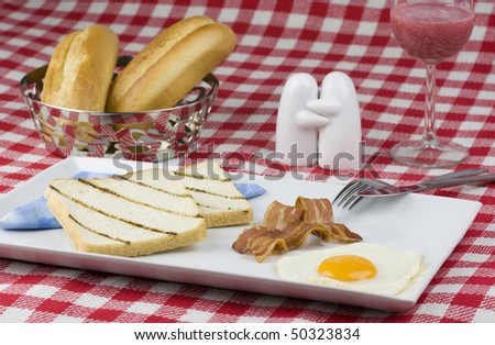 Hearty breakfast with toast, bacon and egg. - stock photo