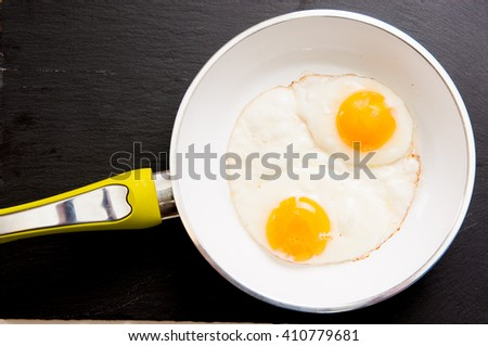 hearty omega three free range large fried eggs in a skillet - stock photo