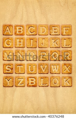 Heat branded alphabet on oak wood and additional blank board so you can build your message - stock photo