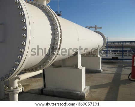 Heat exchangers in a refinery. The equipment for oil refining. - stock photo