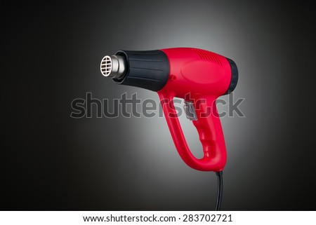 Heat gun isolated on black gradiant background
