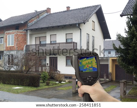 Heat Leak Detection with Infrared Camera - stock photo