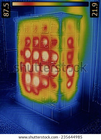 Heat Loss Detection of Old Tiled Stove - stock photo