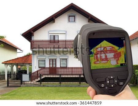 Heat Loss Detection of the House Facade With Infrared Thermal Camera - stock photo