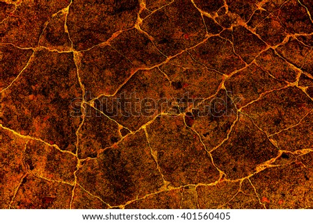heat red cracked ground texture after eruption volcano - stock photo