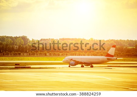 Heat waves distort jet airplane that is on the runway prior departure - stock photo
