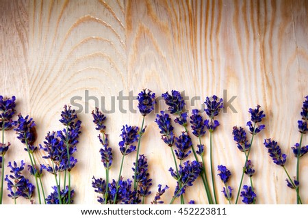 Heather flowers frame on wooden background - stock photo