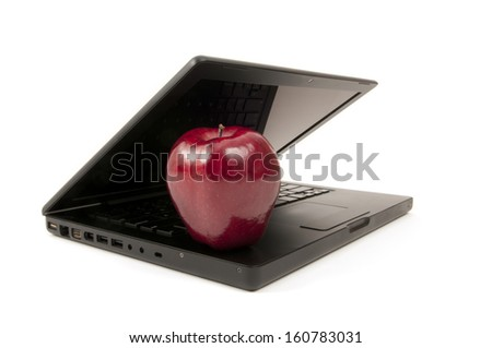 Heathly computer with an apple resting on the keyboard