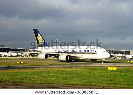 HEATHROW, ENGLAND -15 DECEMBER 2015- A double-decker Airbus A380 super jumbo jet from Singapore Airlines (SQ) at the London Heathrow International Airport (LHR). - stock photo