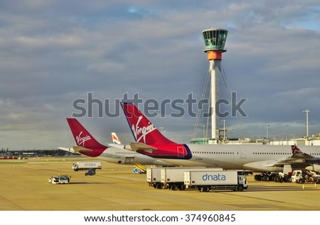 HEATHROW, ENGLAND -3 FEBRUARY 2016- An Airbus A340 airplane from the British airline Virgin Atlantic (VS) at the London Heathrow International Airport (LHR). - stock photo