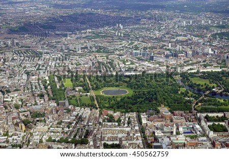 HEATHROW, ENGLAND -28 JUNE 2016- Aerial view of Central London and the Thames River in approach at London Heathrow International Airport (LHR). - stock photo