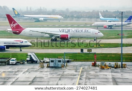 HEATHROW, ENGLAND -16 MARCH 2015- A Virgin Atlantic (VS) Boeing 787 Dreamliner is getting ready for takeoff amidst a traffic jam of other planes at London Heathrow International Airport (LHR). - stock photo