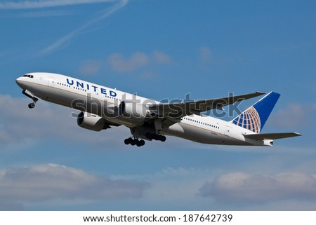 HEATHROW, LONDON, UK - April 10: United Airlines Boeing 777 (N774UA) taking off on April 10, 2014 at London Heathrow Airport, London, UK. - stock photo