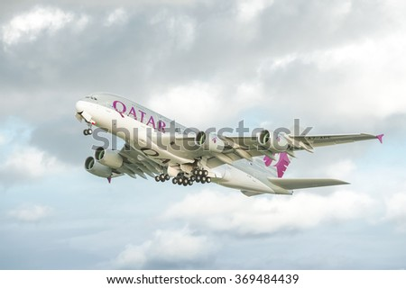 HEATHROW, LONDON, UK - JANUARY 28: Qatar Airways Airbus A380 take-off catching the last rays of sunshine before rain rolls in over Heathrow Airport, London, UK on January 28, 2016