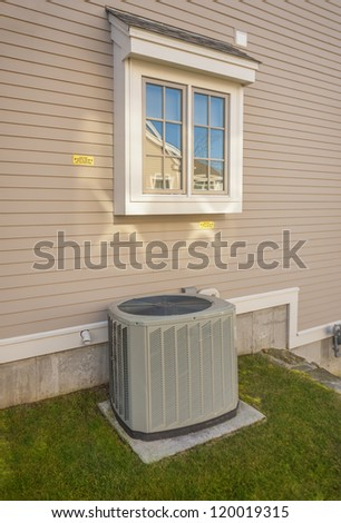 Heating and AC unit used in a residential home - stock photo
