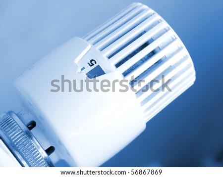 Heating radiator with regulator - stock photo