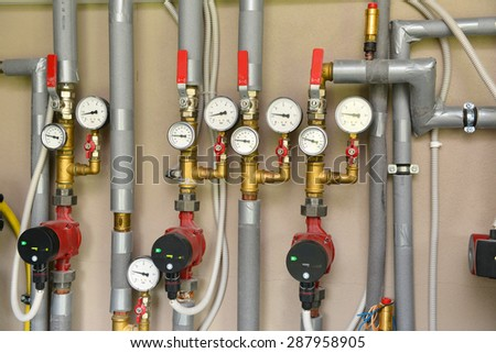 Heating system in a boiler room - stock photo