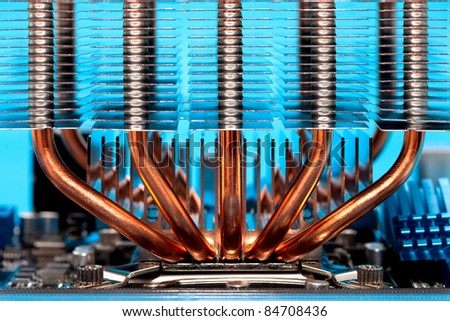 heatpipes and radiator mounted on computers processor - cooling system - stock photo