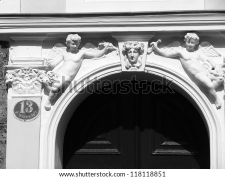 Heavely guards A front door with two sculptures from angels. - stock photo