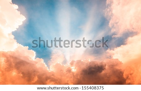 Heaven light ray from sun behind cloud in the blue sky - stock photo
