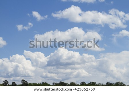 Heavenly background with a lot of clouds and bright sunlight.