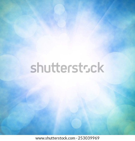 Heavenly blue sky with bright sunshine and light beams - stock photo