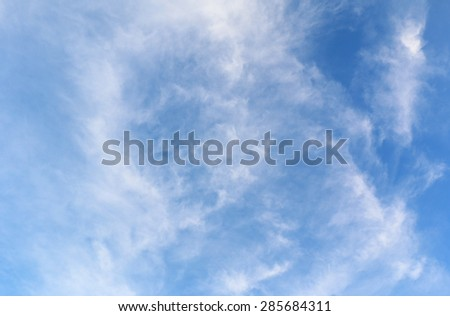 Heavenly blue sky with puffy clouds - stock photo