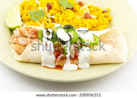 Heavenly enchilada with all the fixings begging to be eaten - stock photo