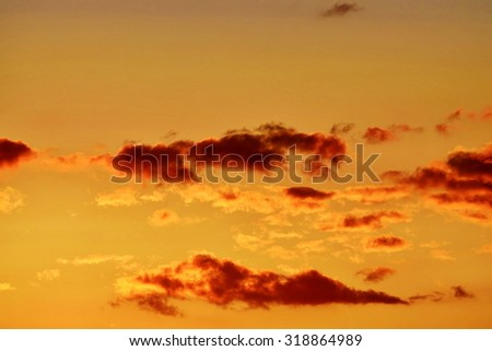 Heavenly landscape with crimson clouds - stock photo